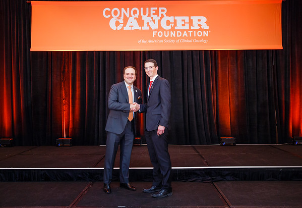 Special Merit Award Recipient Todd Gibson, PhD with Thomas G. Roberts, Jr., MD, Chair of the Conquer Cancer Foundation Board of Directors, during 2017 Grants & Awards Ceremony and Reception