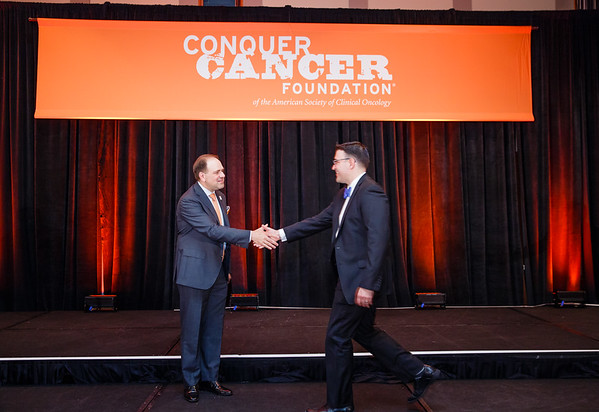 2017 Young Investigator Award Recipient Justin Taylor, MD  with Thomas G. Roberts, Jr., MD, Chair of the Conquer Cancer Foundation Board of Directors, during 2017 Grants & Awards Ceremony and Reception
