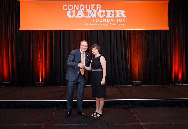 2017 Young Investigator Award Recipient Yvonne Mowery, MD, PhD with Thomas G. Roberts, Jr., MD, Chair of the Conquer Cancer Foundation Board of Directors, during 2017 Grants & Awards Ceremony and Reception