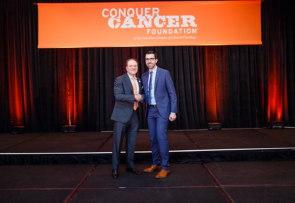 2016 Medical Student Rotation Recipient Daniel Lage with Thomas G. Roberts, Jr., MD, Chair of the Conquer Cancer Foundation Board of Directors, during 2017 Grants & Awards Ceremony and Reception