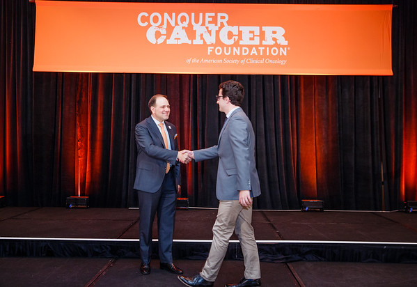 Special Merit Award Recipient James Bates, MD with Thomas G. Roberts, Jr., MD, Chair of the Conquer Cancer Foundation Board of Directors, during 2017 Grants & Awards Ceremony and Reception