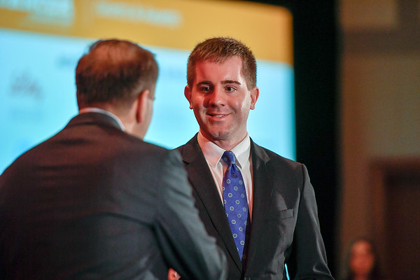 2017 YIA Recipient Andrew Brandmaier, MD, PhD with Thomas G. Roberts, Jr., MD, Chair of the Conquer Cancer Foundation Board of Directors, during 2017 Grants & Awards Ceremony and Reception