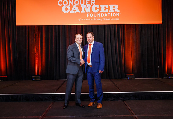 2017 Career Development Award Recipient Adi Diab, MD with Thomas G. Roberts, Jr., MD, Chair of the Conquer Cancer Foundation Board of Directors, during 2017 Grants & Awards Ceremony and Reception