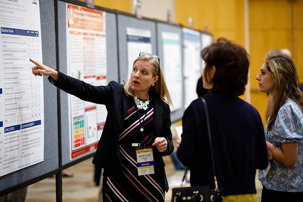 Attendees presents Poster Session A