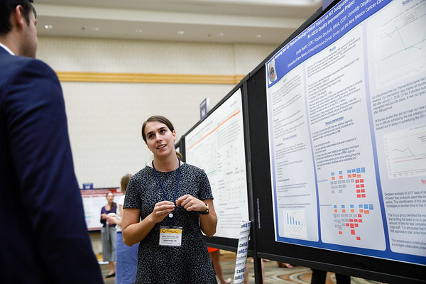 "Kaylee Deutsch presenting her poster on abstract #297, ""Improving Start-up Times in Oncology Clinical Trials: An ASCO Quality Improvement Project"" during Poster Session B"