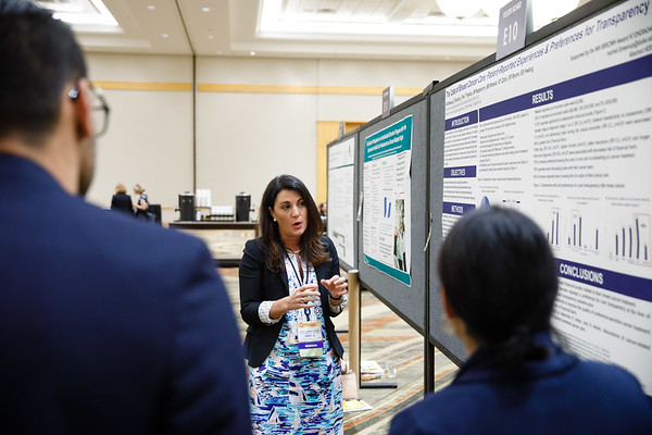 "Rachel Adams Greenup, MD, MPH, presenting her poster on abstract #207, ""The Costs of Breast Cancer Care: Patient-Reported Experiences and Preferences for Transparency"""