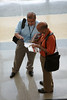 Orlando, FL - ASCO 2009 Annual Meeting: Attendees look through program materials at the Orange County Convention center here today, Friday May 29, 2009 during the American Society of Clinical Oncology's (ASCO) 45th Annual Meeting. The meeting attracts more than 25,000 oncologists, cancer researchers and cancer care professionals from more than 100 countries. Photo by © ASCO/Scott Morgan 2009, ASCO Contact: Kelly Powell/Communications Dept.; 571-483-1365. Technical Questions: todd@toddbuchanan.com; Phone: 612-226-5154.