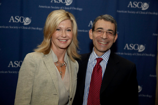 Orlando, FL - ASCO 2009 Annual Meeting: Singer, actress and breast cancer survivor, Olivia Newton-John with ASCO officals at the American Society for Clinical Oncology Annual Meeting here today, Sunday May 31, 2009. Over 25,000  physicians, researchers and healthcare professionals from over 80 countries are attending the meeting which is being held at the Orange County Convention center and features the latest cancer  research in the areas of basic and clinical science. Date: Sunday May 31, 2009 Photo by © ASCO/Todd Buchanan 2009 Technical Questions: todd@toddbuchanan.com; Phone: 612-226-5154.