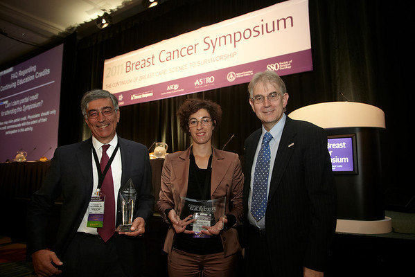 San Francisco, CA -  Breast Cancer Symposium 2011 - The Continuum of Breast Care: Science to Survivorship -  Luca Gianni, MD, left,  and Stefania Zambelli receives the Gianni Bonadonna Breast Cancer Award and Fellowship (respectively) from George Sledge, MD during the Breast Cancer Symposium here today, Thursday September 8, 2011 at the San Francisco Marriott. Over 1100 attendees received updates on the latest research in breast cancer detection, care, prevention and treatment from physicians, clinicians and researchers from around the world.  Date: Thursday September 8, 2011 Photo by © ASCO/Todd Buchanan 2011 Technical Questions: todd@toddbuchanan.com; Phone: 612-226-5154.