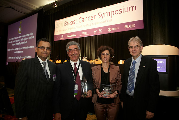 San Francisco, CA -  Breast Cancer Symposium 2011 - The Continuum of Breast Care: Science to Survivorship -  Luca Gianni, MD, center left,  and Stefania Zambelli, center right, receive the Gianni Bonadonna Breast Cancer Award and Fellowship (respectively) from Yasir Nagarwala, MD (GSK), left, and George Sledge, MD, right,  during the Breast Cancer Symposium here today, Thursday September 8, 2011 at the San Francisco Marriott. Over 1100 attendees received updates on the latest research in breast cancer detection, care, prevention and treatment from physicians, clinicians and researchers from around the world.  Date: Thursday September 8, 2011 Photo by © ASCO/Todd Buchanan 2011 Technical Questions: todd@toddbuchanan.com; Phone: 612-226-5154.