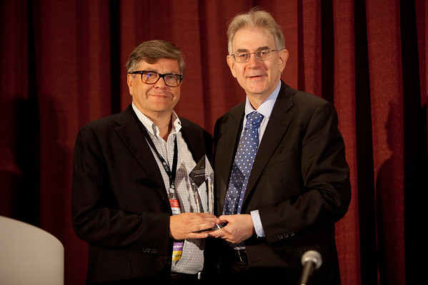 Chicago, IL - ASCO 2012 Annual Meeting: - Matti S. Aapro, MD, receives the B. J. Kennedy Award and Lecture for Scientific Excellence in Geriatric Oncology from George W. Sledge, Jr., MD,  at the American Society for Clinical Oncology (ASCO) Annual Meeting here today, Sunday June 3, 2012.  Over 31,000 physicians, researchers and healthcare professionals from over 100 countries are attending the meeting which is being held at the McCormick Convention center and features the latest cancer research in the areas of basic and clinical science. Photo by © ASCO/Scott Morgan 2012 Technical Questions: todd@toddbuchanan.com; ASCO Contact: photos@asco.org