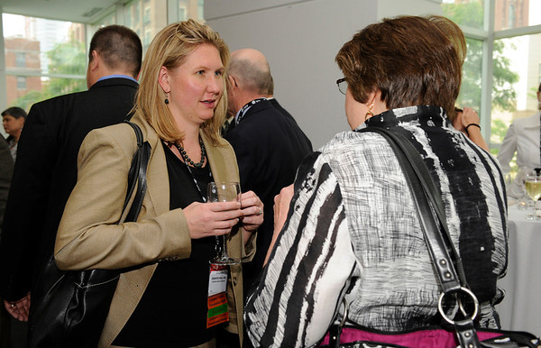 Chicago, IL - ASCO 2011 Annual Meeting: - Attendees  during the State Affiliate President's Reception at the American Society for Clinical Oncology (ASCO) Annual Meeting here today, Sunday June 3, 2012.  Over 25,000 physicians, researchers and healthcare professionals from over 100 countries are attending the meeting which is being held at the McCormick Convention center and features the latest cancer research in the areas of basic and clinical science. Photo by © ASCO/Phil McCarten 2012 Technical Questions: todd@toddbuchanan.com; ASCO Contact: photos@asco.org