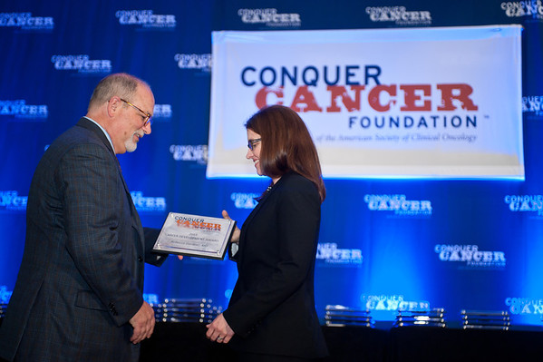 Chicago, IL - ASCO 2013 Annual Meeting: -Career Development Award winners receive their plaques during the 2013 Grants and Awards Ceremony and Reception at the American Society for Clinical Oncology (ASCO) Annual Meeting here today, Sunday June 2, 2013.  Over 30,000 physicians, researchers and healthcare professionals from over 100 countries are attending the meeting which is being held at the McCormick Convention center and features the latest cancer research in the areas of basic and clinical science. Photo by © ASCO/Brian Powers 2013 Technical Questions: todd@toddbuchanan.com; ASCO Contact: photos@asco.org
