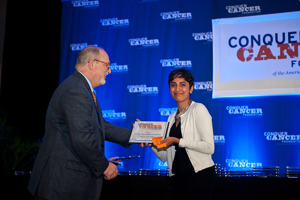 Chicago, IL - ASCO 2013 Annual Meeting: - Young Investigator Award winners receive their plaques during the 2013 Grants and Awards Ceremony and Reception at the American Society for Clinical Oncology (ASCO) Annual Meeting here today, Sunday June 2, 2013.  Over 30,000 physicians, researchers and healthcare professionals from over 100 countries are attending the meeting which is being held at the McCormick Convention center and features the latest cancer research in the areas of basic and clinical science. Photo by © ASCO/Brian Powers 2013 Technical Questions: todd@toddbuchanan.com; ASCO Contact: photos@asco.org
