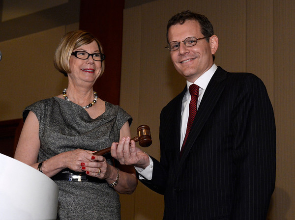 Chicago, IL - ASCO 2013 Annual Meeting: - ASCO past President Dr. Sandra Swain passes the gavel to President Dr. Cliff Hudis during the Annual Business Meeting at the American Society for Clinical Oncology (ASCO) Annual Meeting here today, Monday June 3, 2013.  Over 30,000 physicians, researchers and healthcare professionals from over 100 countries are attending the meeting which is being held at the McCormick Convention center and features the latest cancer research in the areas of basic and clinical science. Photo by © ASCO/Phil McCarten 2013 Technical Questions: todd@toddbuchanan.com; ASCO Contact: photos@asco.org
