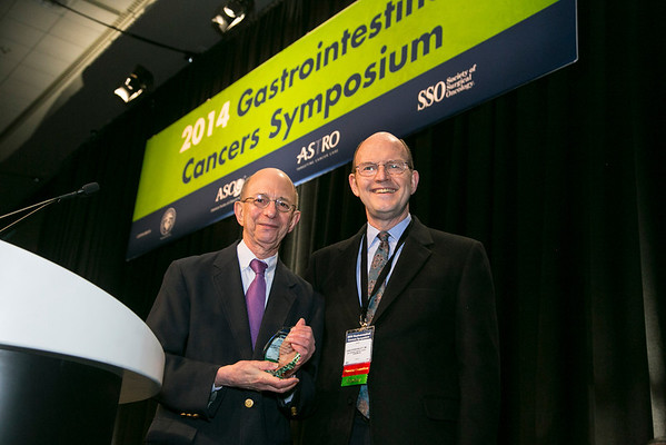 "San Francisco, CA -GI Cancers Symposium 2014: Charles Lightdale, MD , left, receives the Keynote lecture award from hristopher Willett, MD and gives the talk titled ""Evolution of Endoscopy in Esophageal Cancer: From Detection to Staging to Therapy"" at the 2014 Gastrointestinal Cancers Symposium here today, Thursday January 16, 2014. Over 3,300 physicians, researchers, patient advocates and healthcare professionals from over 50 countries attended the meeting which features the latest research on gastrointestinal cancer treatment and prevention. Photo by © ASCO/Todd Buchanan 2014 Technical Questions: todd@medmeetingimages.com"