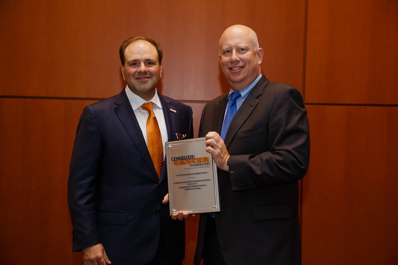 Thomas Roberts, Jr., MD, Chair of the Conquer Cancer Foundation, presenting the Clinical Trials Participation Awards to CHI Health St. Francis Cancer Treatment Center, represented by Mehmet Copur, MD, FACP, during Clinical Trials Participation Awards