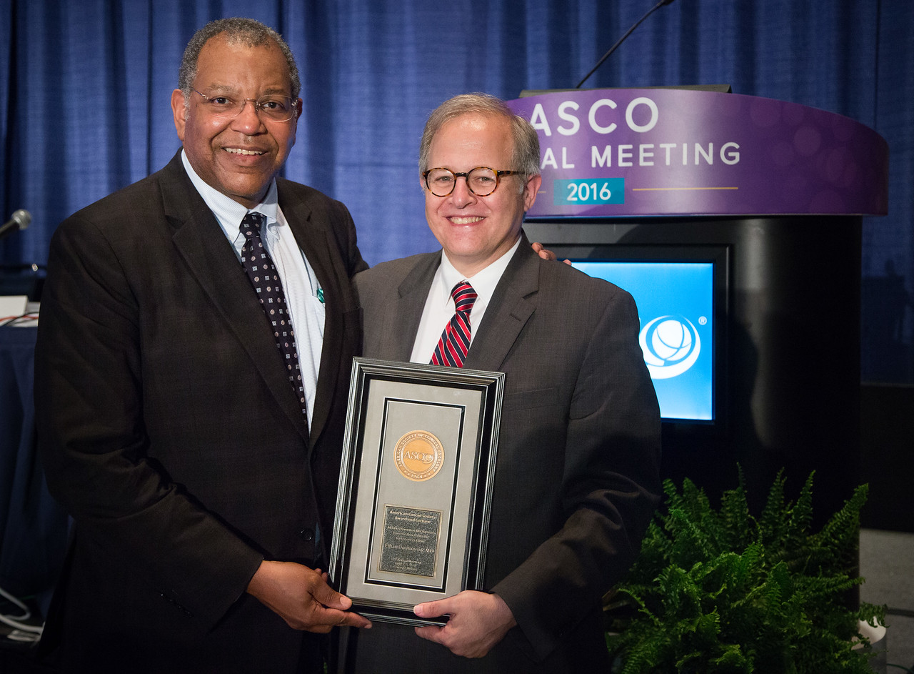 Otis Brawley, MD, presenting the ASCO-ACS Award to Ethan Dmitrovsky, MD during ASCO-American Cancer Society Award and Lecture