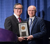 Peter Yu, MD, FACP, FASCO, presenting the B.J. Kennedy Award to Pierre-Louis Soubeyran, MD, PhD, during B.J. Kennedy Award and Lecture for Scientific Excellence in Geriatric Oncology