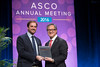 Peter Yu, MD, FACP, FASCO, presenting the Gianni Bonadonna Fellowship Plaque to Carmine De Angelis, MD, during Gianni Bonadonna Breast Cancer Award and Lecture