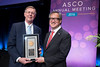 Peter Yu, MD, FACP, FASCO, presenting the Gianni Bonadonna Award to C. Kent Osborne, MD, FASCO, during Gianni Bonadonna Breast Cancer Award and Lecture