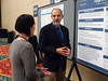 "Charles David Blanke, MD, Oregon Health & Science University, presenting the poster for Abstract #44, ""Usage of Oregon's Death With Dignity Act (DWDA),"" chats during Poster Session B"