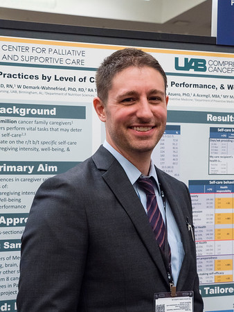 "J Nicholas Dionne-Odom, PhD, RN, The University of Alabama at Birmingham, presenting the poster for Abstract #239, ""Differences in self-care behaviors by varying levels of caregiving intensity, performance, and well-being among family caregivers of patients with high-mortality cancer,"" during Poster Session B"