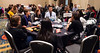 Early-career attendees networking with faculty at tables during Trainee & Early Career Luncheon