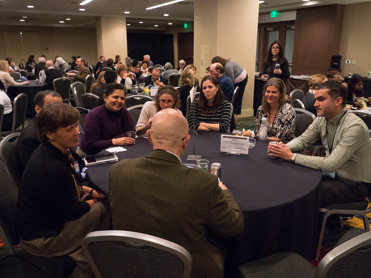 Faculty and attendees discussing topics in oncology and cancer survivorship - Meet the Faculty Networking Roundtables