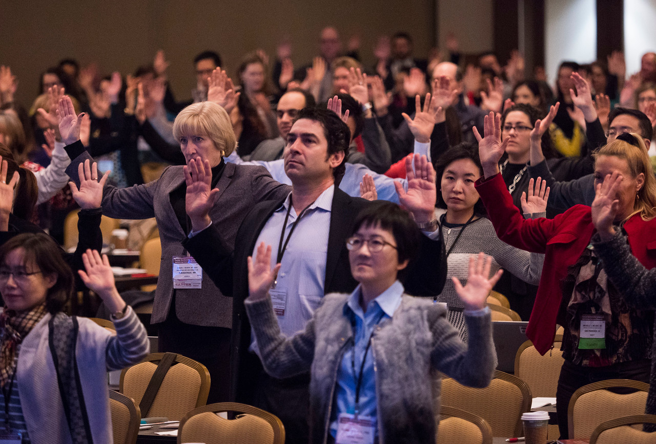 Attendees participate in Rejuvenation Exercises - General Session 6