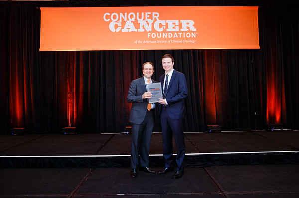 2017 Young Investigator Award Recipient Joshua Walker, MD, PhD with Thomas G. Roberts, Jr., MD, Chair of the Conquer Cancer Foundation Board of Directors, during 2017 Grants & Awards Ceremony and Reception