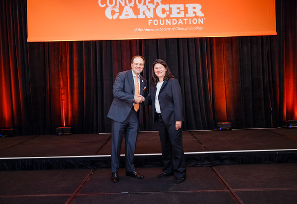 2017 Young Investigator Award Recipient Jennifer Rosenbluth, MD, PhD with Thomas G. Roberts, Jr., MD, Chair of the Conquer Cancer Foundation Board of Directors, during 2017 Grants & Awards Ceremony and Reception