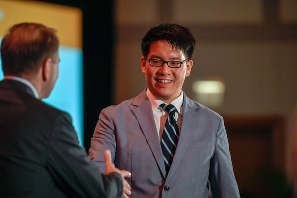 2017 YIA Recipient Samuel Ng, MD, PhD with Thomas G. Roberts, Jr., MD, Chair of the Conquer Cancer Foundation Board of Directors, during 2017 Grants & Awards Ceremony and Reception
