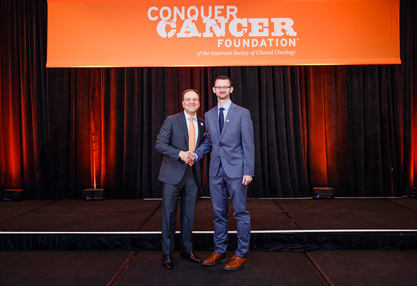 2017 Young Investigator Award Recipient Robert Smyth, MB, MSc with Thomas G. Roberts, Jr., MD, Chair of the Conquer Cancer Foundation Board of Directors, during 2017 Grants & Awards Ceremony and Reception