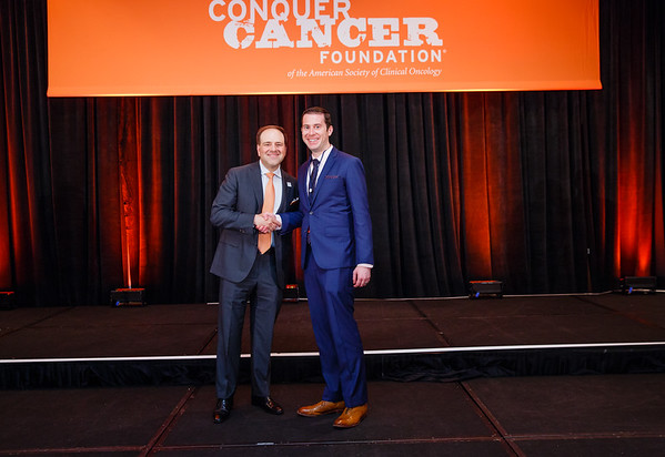 2017 Young Investigator Award Recipient Michael Cecchini, MD with Thomas G. Roberts, Jr., MD, Chair of the Conquer Cancer Foundation Board of Directors, during 2017 Grants & Awards Ceremony and Reception