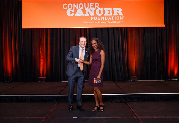 2016 Medical Student Rotation Recipient Adrienne Nicole Hawkins Baksh with Thomas G. Roberts, Jr., MD, Chair of the Conquer Cancer Foundation Board of Directors, during 2017 Grants & Awards Ceremony and Reception