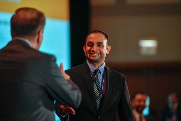 2017 YIA Recipient Rajarsi Mandal, MD with Thomas G. Roberts, Jr., MD, Chair of the Conquer Cancer Foundation Board of Directors, during 2017 Grants & Awards Ceremony and Reception