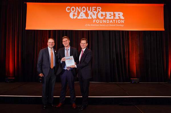2017 Young Investigator Award Recipient Stephen Schleicher, MD, MBA with Thomas G. Roberts, Jr., MD, Chair of the Conquer Cancer Foundation Board of Directors, and Clifford A. Hudis, MD, FACP, FASCO, CEO of ASCO during 2017 Grants & Awards Ceremony and Reception