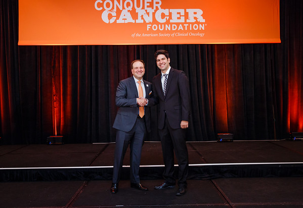 2017 IDEA Recipient Daniel Araujo, MD with Thomas G. Roberts, Jr., MD, Chair of the Conquer Cancer Foundation Board of Directors, during 2017 Grants & Awards Ceremony and Reception