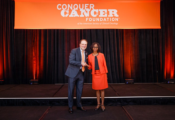 2017 Resident Travel Award Award Recipient Oumoul Barry, MD with Thomas G. Roberts, Jr., MD, Chair of the Conquer Cancer Foundation Board of Directors, during 2017 Grants & Awards Ceremony and Reception
