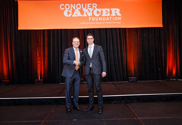 2017 Career Development Award Recipient Scott Bratman, MD, PhD with Thomas G. Roberts, Jr., MD, Chair of the Conquer Cancer Foundation Board of Directors, during 2017 Grants & Awards Ceremony and Reception