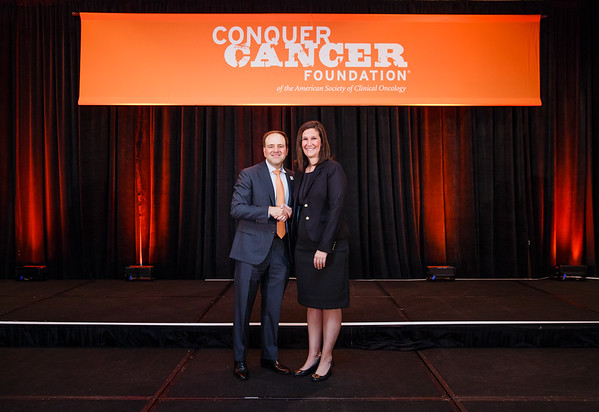2017 Young Investigator Award Recipient Kristen Marrone, MD with Thomas G. Roberts, Jr., MD, Chair of the Conquer Cancer Foundation Board of Directors, during 2017 Grants & Awards Ceremony and Reception