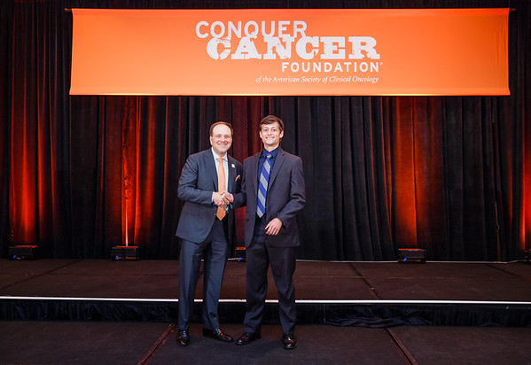 2017 Young Investigator Award Recipient Aaron Mitchell, MD with Thomas G. Roberts, Jr., MD, Chair of the Conquer Cancer Foundation Board of Directors, during 2017 Grants & Awards Ceremony and Reception