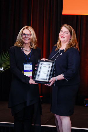 Women Who Conquer Cancer Mentorship Award Recipient Elizabeth Shpall, MD with Meg Eckenroad from Hologic, Inc during 2017 Grants & Awards Ceremony and Reception