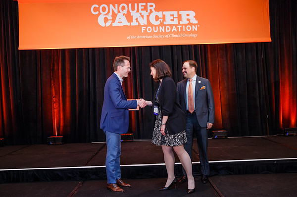 2017 Gianni Bonadonna Breast Cancer Research Fellowship Recipient Ana Christina Garrido-Castro, MD with Axel Hoos of GlaxoSmithKline and Thomas G. Roberts, Jr., MD, Chair of the Conquer Cancer Foundation Board of Directors, during 2017 Grants & Awards Ceremony and Reception