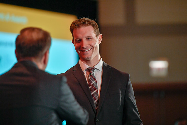 2017 YIA Recipient Joshua Sasine, MD with Thomas G. Roberts, Jr., MD, Chair of the Conquer Cancer Foundation Board of Directors, during 2017 Grants & Awards Ceremony and Reception