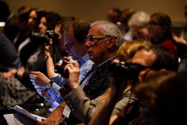 Attendees listen during Plenary Press Briefing