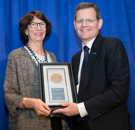 Clifford Hudis, MD, FACP, FASCO, presenting the Partners in Progress Award to Susan Weiner, PhD, during Pediatric Oncology Award and Lecture and Presentation of the Partners in Progress Award