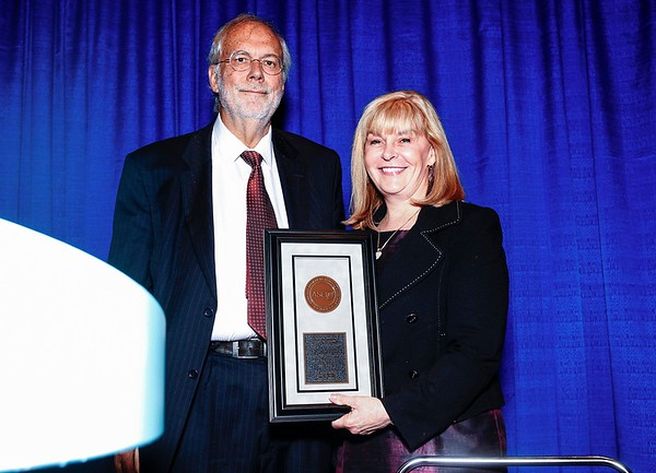 Julie Vose, MD, MBA, FASCO, presenting the B.J. Kennedy Award to Jean Pierre Droz, MD, PhD, during B.J. Kennedy Award and Lecture for Scientific Excellence in Geriatric Oncology
