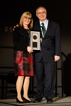Julie Vose, MD, MBA, FASCO, presenting the Allen S. Lichter Visionary Leader Award to Patrick Loehrer, MD, FASCO, during Allen S. Lichter Visionary Leader Award and Lecture
